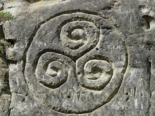 https://pixabay.com/photos/triskele-stone-drawing-rock-stone-52542/